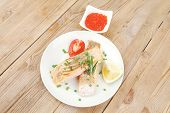 Постер, плакат: healthy fish cuisine : grilled pink salmon steaks on white dish with red caviar over wooden table