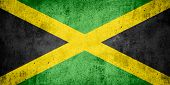stock photo of jamaican  - flag of Jamaica or Jamaican banner on rough pattern texture background - JPG