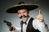 stock photo of sombrero  - Smiling mexican with sombrero isolated on white - JPG