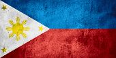stock photo of filipino  - flag of the Philippines or Filipino banner on rough pattern texture background - JPG