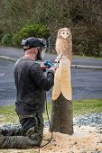 foto of man chainsaw  - The making of an owl sculpture by a chainsaw sculptor here in the latter stages - JPG