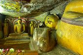 foto of cave  - Insides of caves in ancient Buddhist complex in Dambulla cave temple - JPG