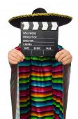 pic of vivid  - Handsome man in vivid poncho holding clapperboard isolated on white - JPG
