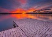 picture of pier a lake  - Beautiful lake landscape with vibrant sunset and pier - JPG