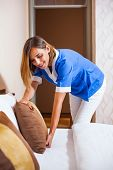 pic of maids  - Image of maid making bed in hotel room - JPG
