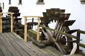 stock photo of water-mill  - Two wooden water wheels next to water mill - JPG