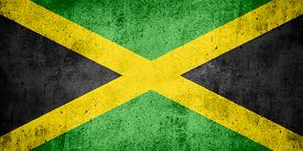 image of jamaican flag  - flag of Jamaica or Jamaican banner on rough pattern texture background - JPG