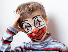 image of pantomime  - little cute real boy with facepaint like clown - JPG