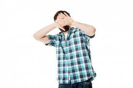 stock photo of prank  - Young handsome afraid man covering his face - JPG