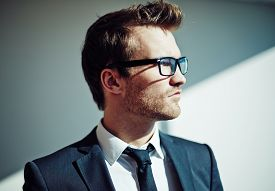 picture of posh  - Side view of posh young man in eyeglasses - JPG
