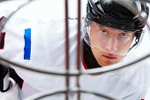 pic of ice hockey goal  - Portrait of hockey player looking at adversary before making goal - JPG