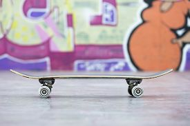 pic of skateboard  - profile view of a skateboard at the skate park  - JPG