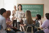 Students playing musical instruments poster