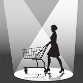 Woman Shopper & Shopping Cart In Spotlight