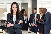 Businesswoman Leader In Modern Office With Businesspeople Working At Background poster