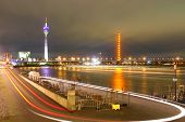 dusseldorf germany-night-scene-includes media-tower and bridge on rhine river