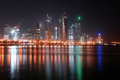 stock photo of qatar  - A cityscape from Doha the capital city of Qatar in the night - JPG