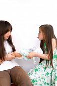 picture of sticking out tongue  - Sisters fight for doll - JPG