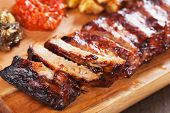 Roasted pork ribs marinated in barbecue sauce and glazed with honey poster