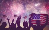 Patriotic holiday. Silhouettes of people holding the Flag of USA. America celebrate 4th of July. poster