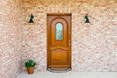 Stylish Wooden Front - Entrance Door In A Detached House - Embedded In A Brick Wall poster