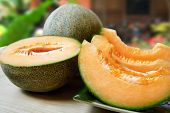 sliced fresh cantaloupe in an outdoor setting