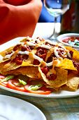 nachos with beef and spicy salsa
