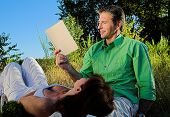 pic of nic  - couple reading a book outdoor at sunset - JPG