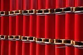 Red oildrums on wooden pallets in an industrial storage