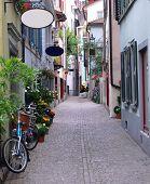 View into the old cobble stone alley Predigerstrasse in Zurich in Switzerland