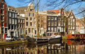 Beautiful houses on a canal in Amsterdam