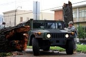 NEW ORLEANS - SEPT 1: A National Guardsman stands next to a Humvee as he inspects damage caused by a