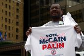 ST PAUL - SEPT 4: Allen McKoy sells McCain-Palin t-shirts outside the Republican party convention venue at the Xcel Energy Center on September 4, 2008 in St Paul, Minnesota.