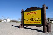 Sign welcoming travelers to the state of New Mexico, facing left