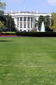 South facade and South lawn of the White House in Washington DC in spring colors, with vertical copy