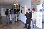 MEXICO CITY - APRIL 28: Patients and visitors line up inside the Mexican Institute of Respiratory Il
