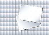A vector illustration of a sheet of blank postage stamps in with larger stamps creating an area for