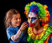 Single parent family. Tired mom after work as clown on birthday on dark background. Adult child rela poster