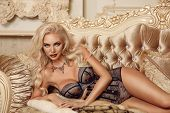 Beautiful Alluring Blond Woman In Sexy Lingerie Lying On Royal Sofa In Luxury Modern Interior. Beaut poster