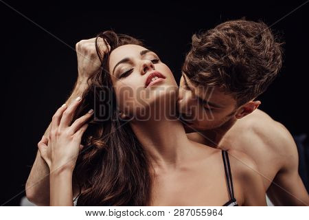 Man Passionately Kissing Beautiful Woman