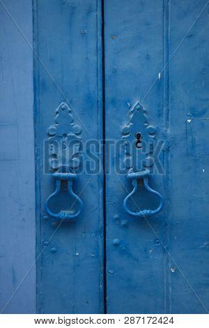Door knockers on the blue