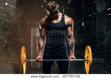 poster of Handsome Strong Athletic Fitness Men Pumping Up Arm Muscles Workout Barbell Curl Fitness Concept Bac
