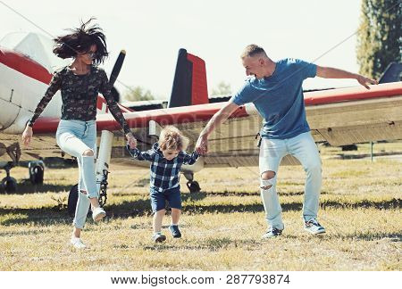 poster of Lets Start Our Journey. Travelling By Air. Family On Vacation Trip. Couple With Boy Child At Plane.