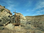 stock photo of chute  - A weathered corral with loading chute in a rocky canyon - JPG