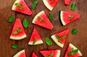 Watermelon Slice On Rustic Wood Background. Flat Lay. Summertime Concept. poster