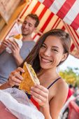 Happy Asian girl eating cuban sandwich at local cafe restaurant in Key West, Florida. Summer travel  poster
