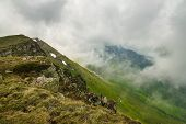 Landscape With Clouds Covering Mountain Peaks. Hiking In Nature On The Top Of The Mountain. Hiking I poster
