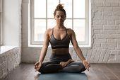 Calm Woman Practicing Yoga, Sitting In Padmasana Pose, Lotus Exercise poster