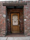 Wood Door Set Into Brick