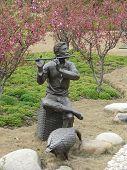 Fluent Player Statue And Peach Flower